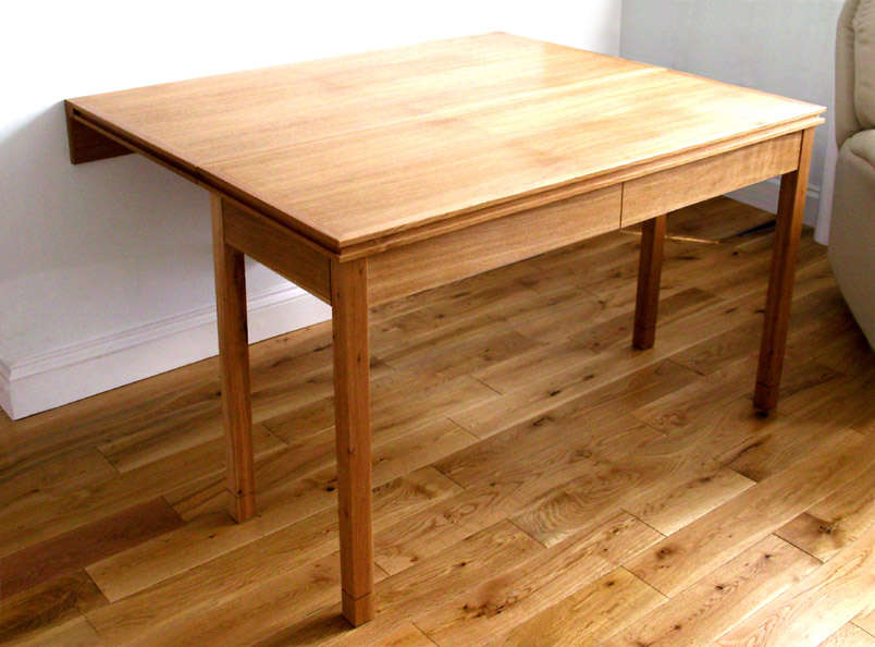'Hulse' Oak table and writing desk joined to form dining table.